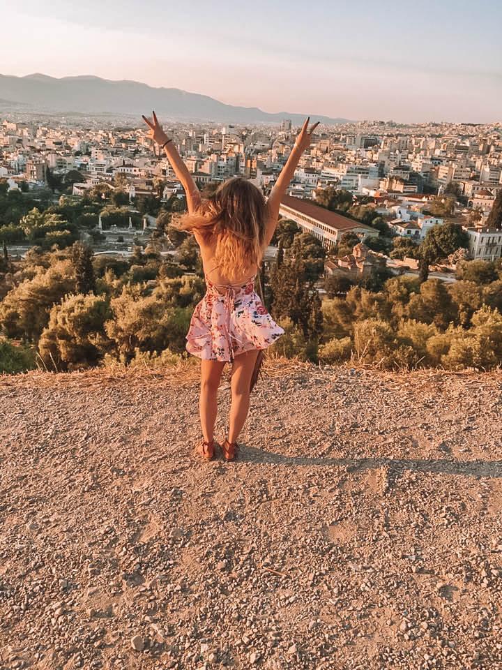 A woman enjoying an evening in Athens Greece