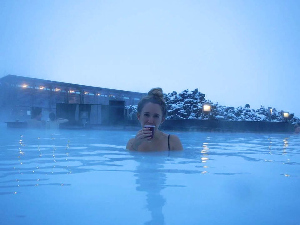A woman enjoying a morning at The Blue Lagoon in Iceland