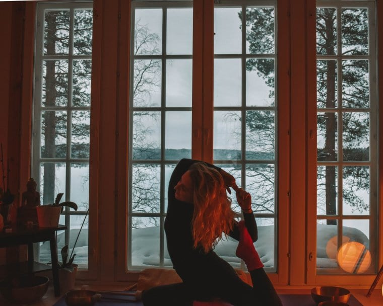 A woman doing one of the most relaxing yoga adventures in Lapland
