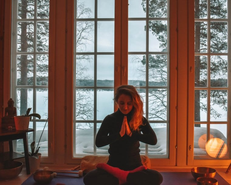 A woman meditating in a Lapland home