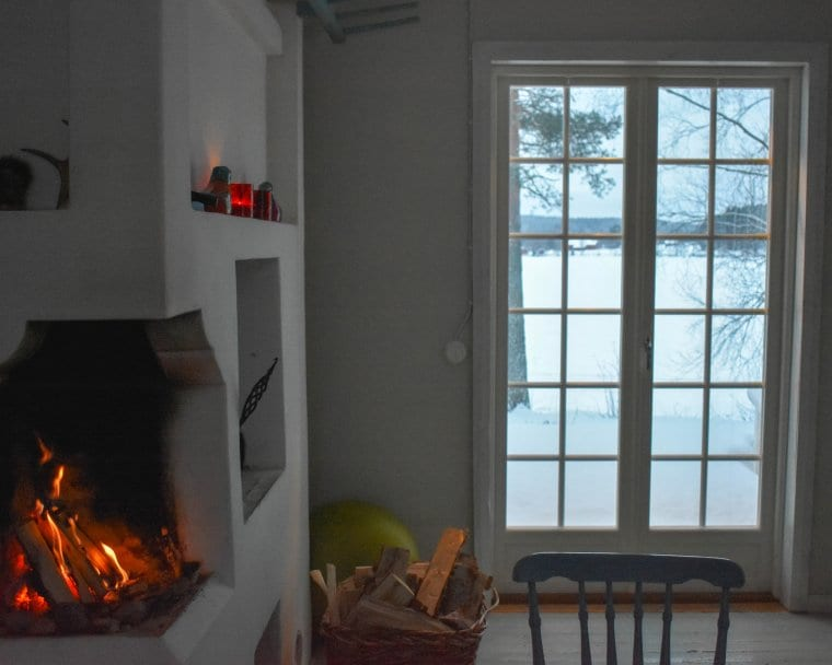 Experiencing hygge in a Lappish home with a warm fire