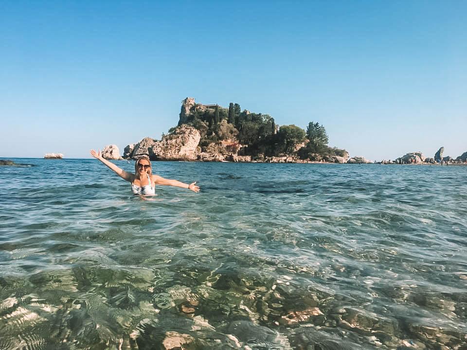 A woman enjoying the Mediterranean Sea in Sicily