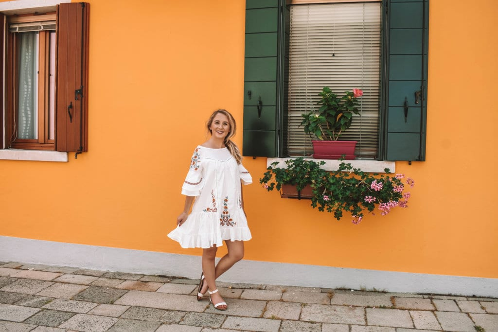 A woman enjoying a summer day in Burano, Italy