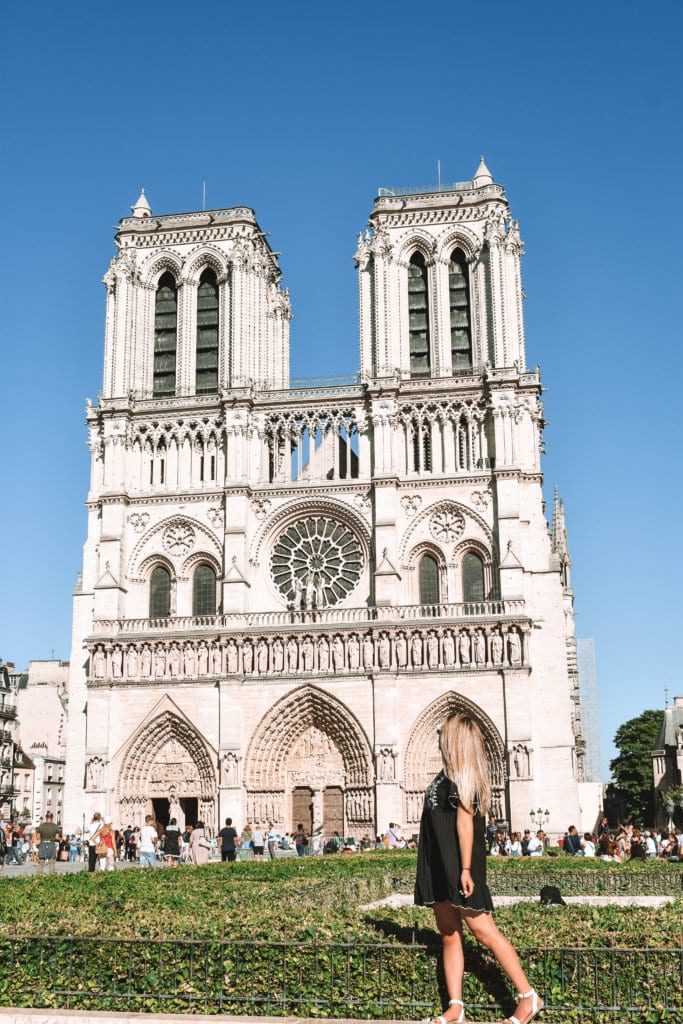 A woman admiring the Notre Dame Cathedral in Paris