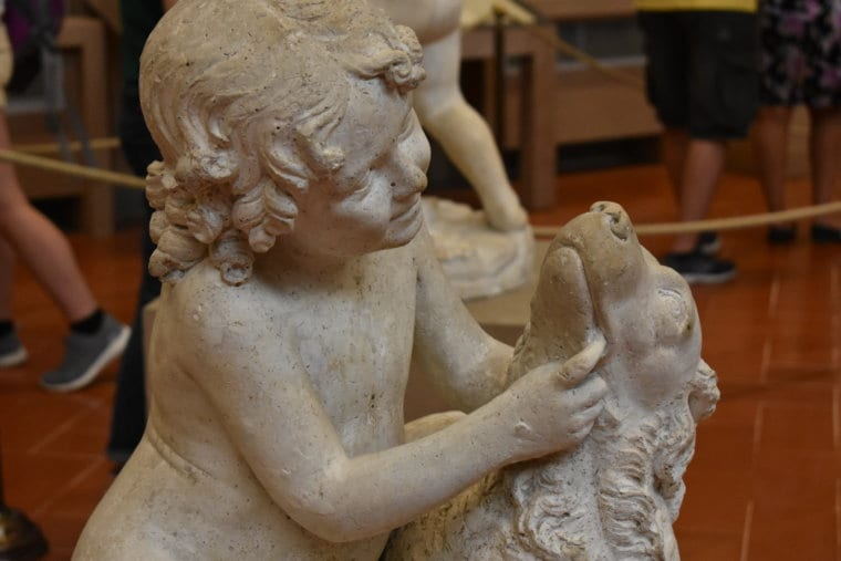 A sculpture of a child and a dog from Michaelangelo