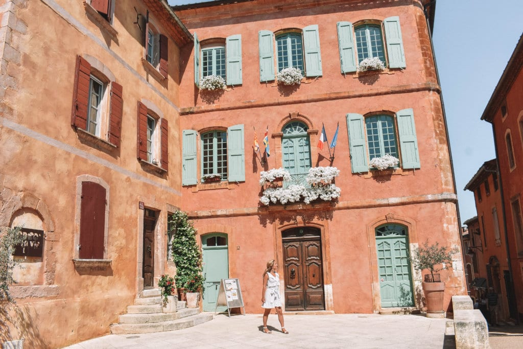 A woman walking around the Provence town of Roussillon, France