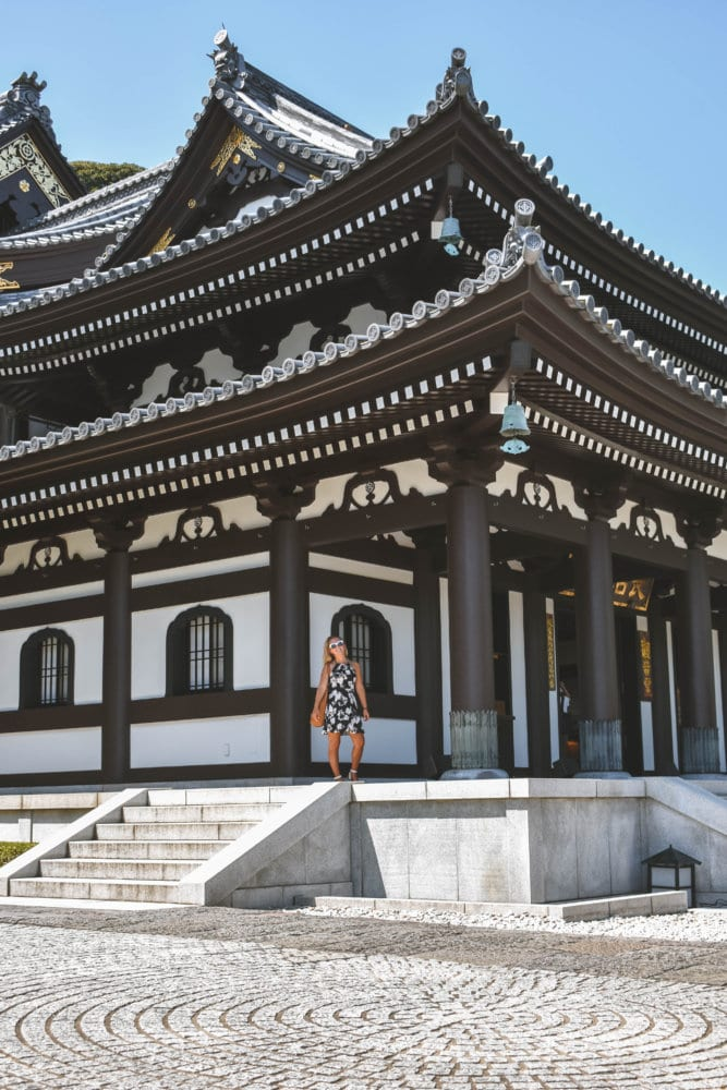 A woman admiring the beauty of Hasedera Temple during a day trip to Kamakura