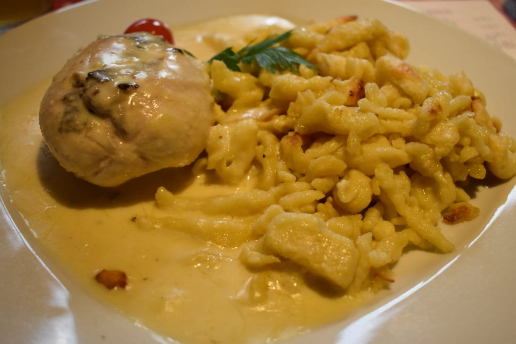 A delicious spatzle and chicken dish from Alsace, France