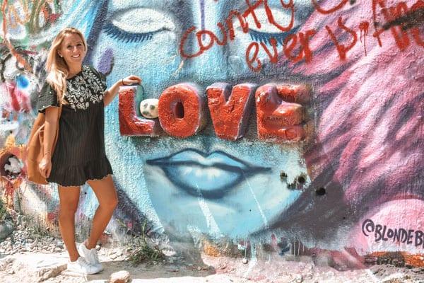 A young woman enjoying graffiti in Austin, Texas
