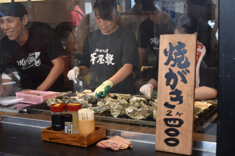 Delicious oysters being prepared in Miyajima