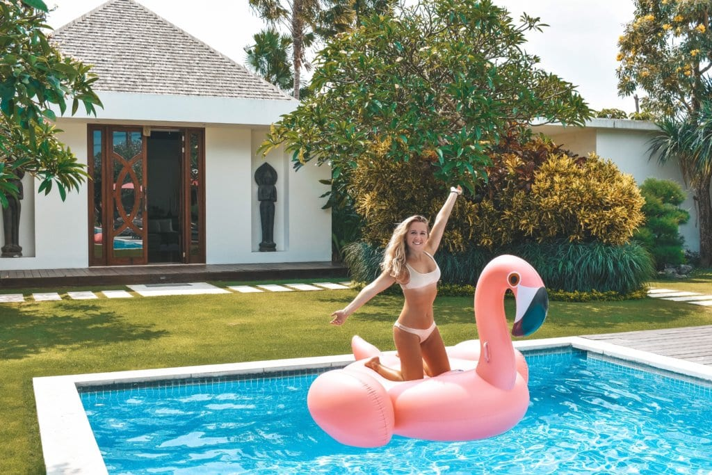 A woman on a pool floaty in Bali