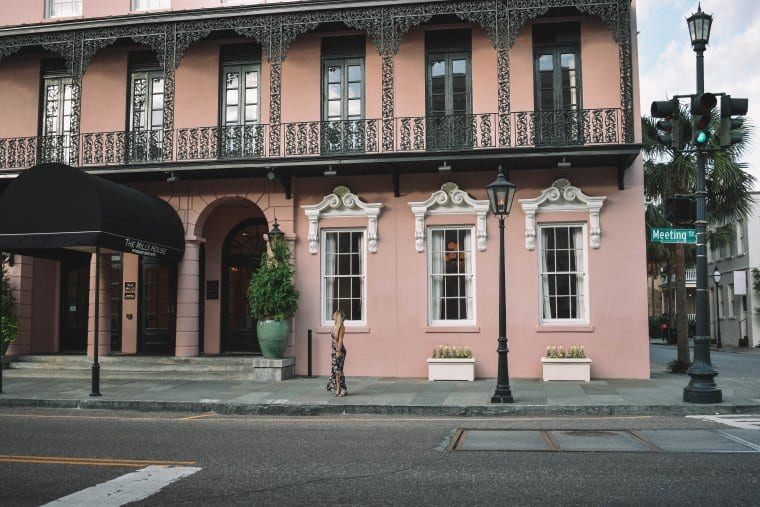 A woman outside of The Mills Hotel in Charleston South Carolina