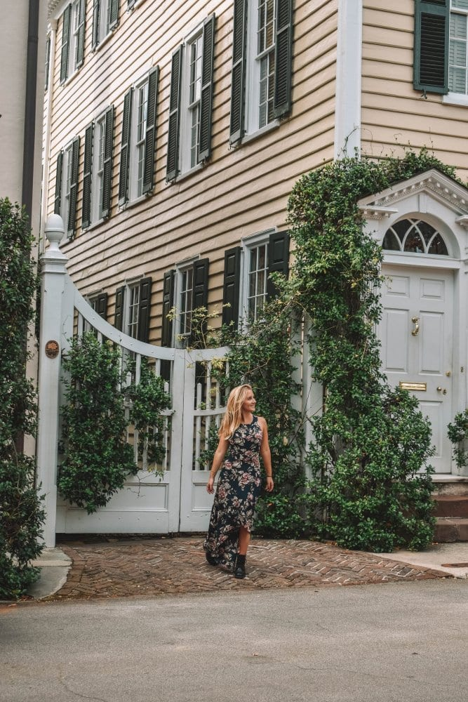 A woman wandering through Charleston's historic district