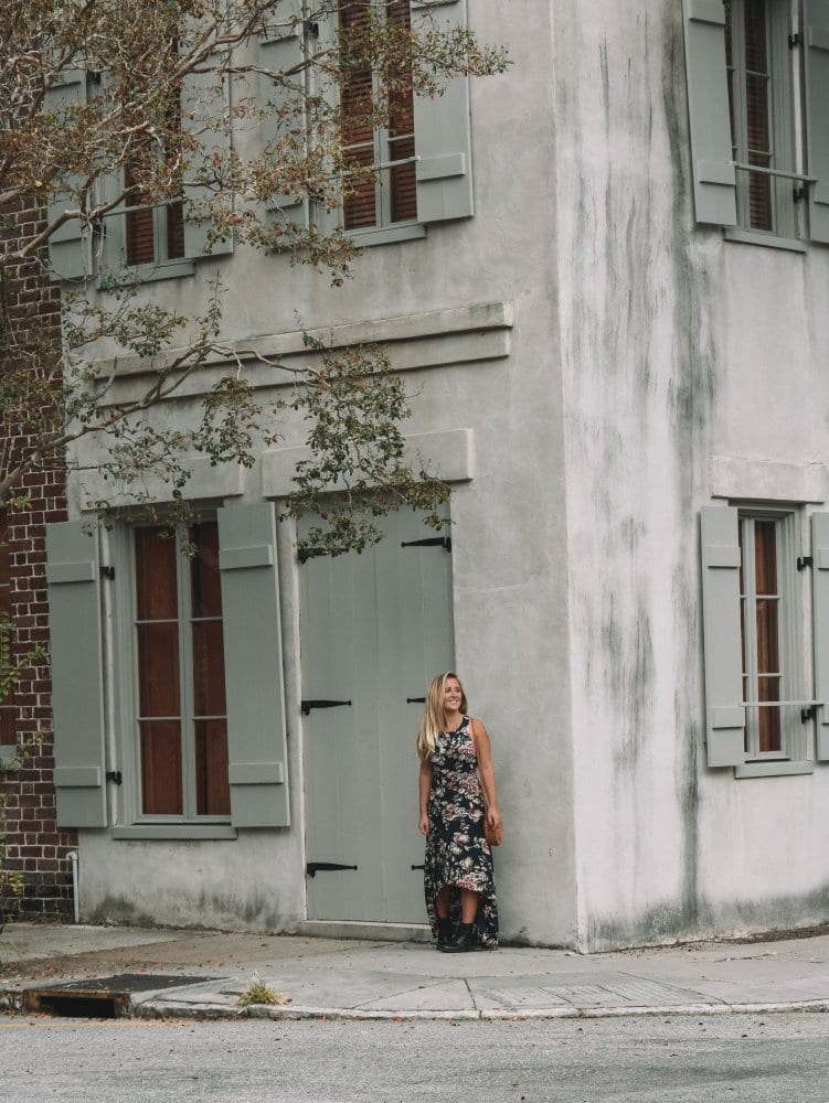 A woman in front of a beautiful building in Charleston