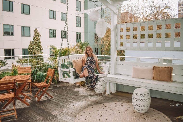 A woman enjoying her vacation on a rooftop in Charleston