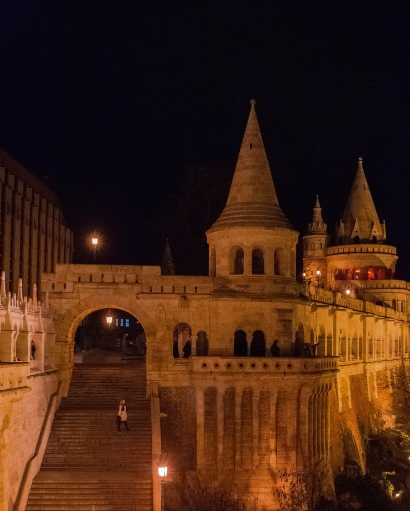 A woman walking around Fisherman's Bastion in Budapest