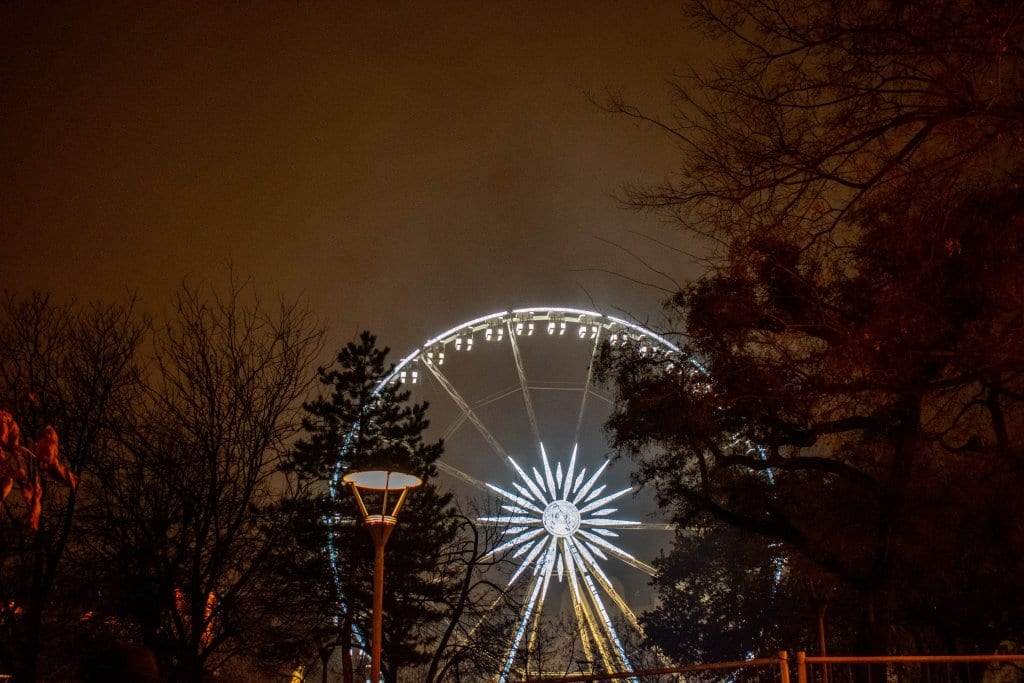A Ferris wheel lit up at night in Budapest
