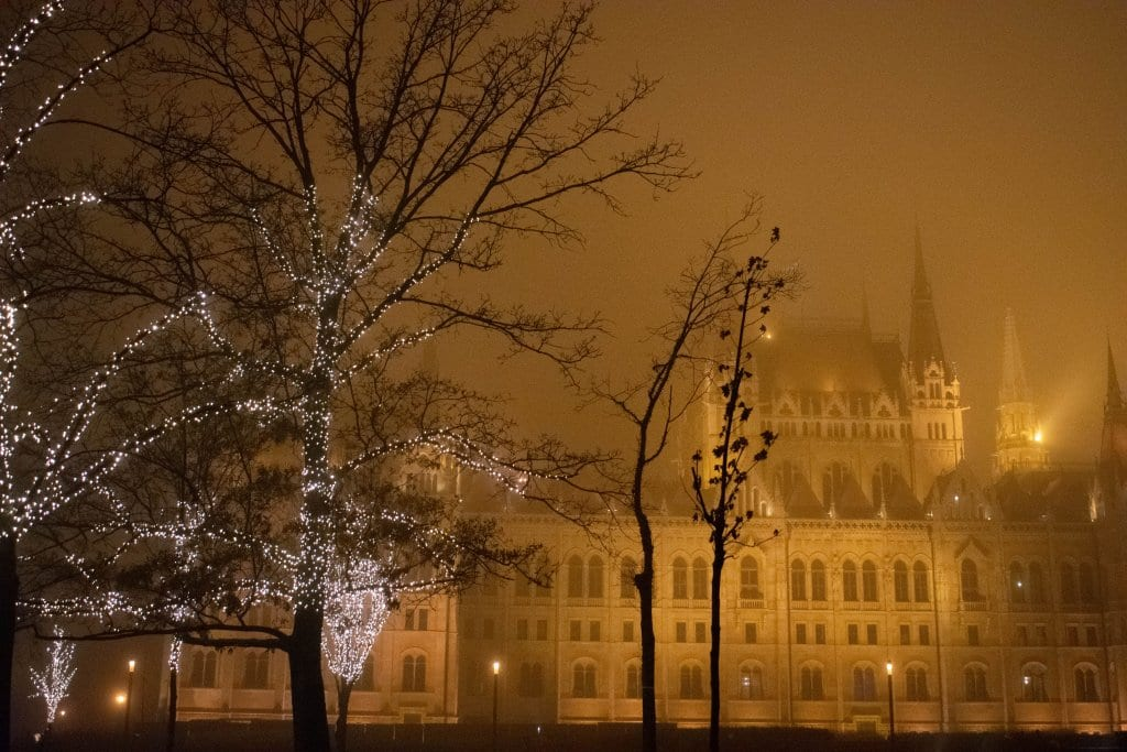 Foggy views of the Hungarian Parliament Building during the Budapest Christmas markets