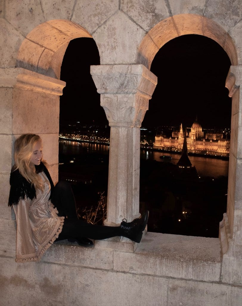 A woman enjoying the night views of Budapest from Fisherman's Bastion during the Budapest Christmas markets