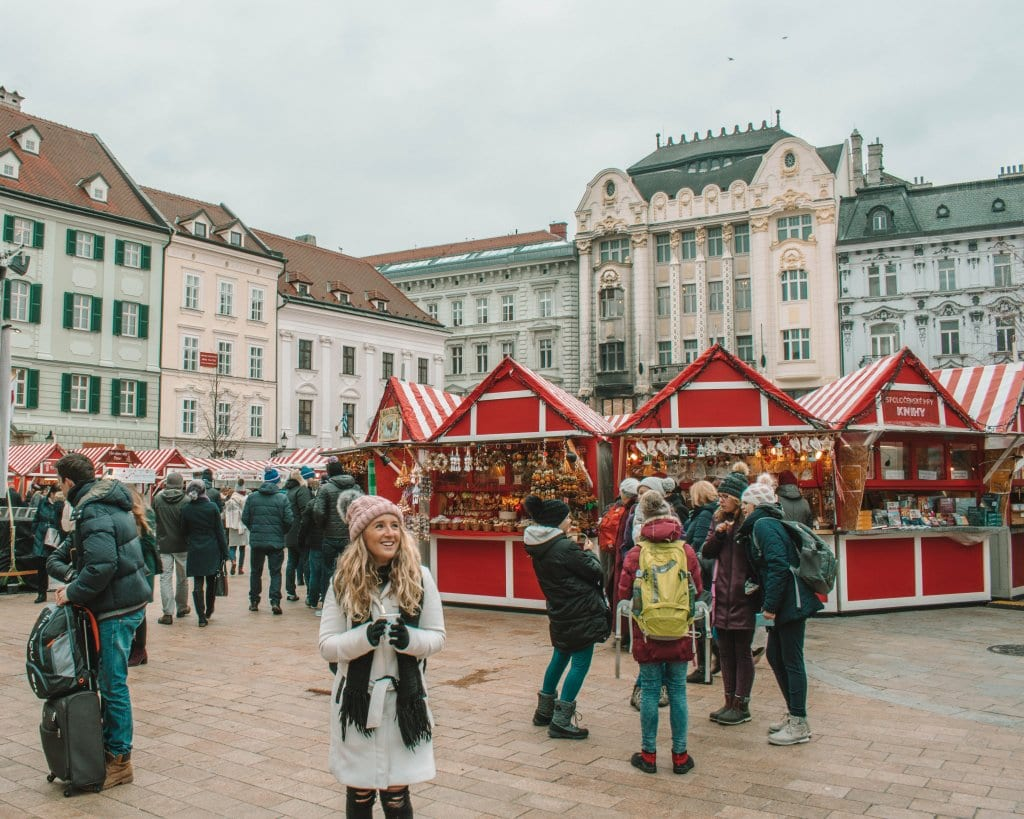 A woman holding mulled wine at the Bratislava Christmas Markets