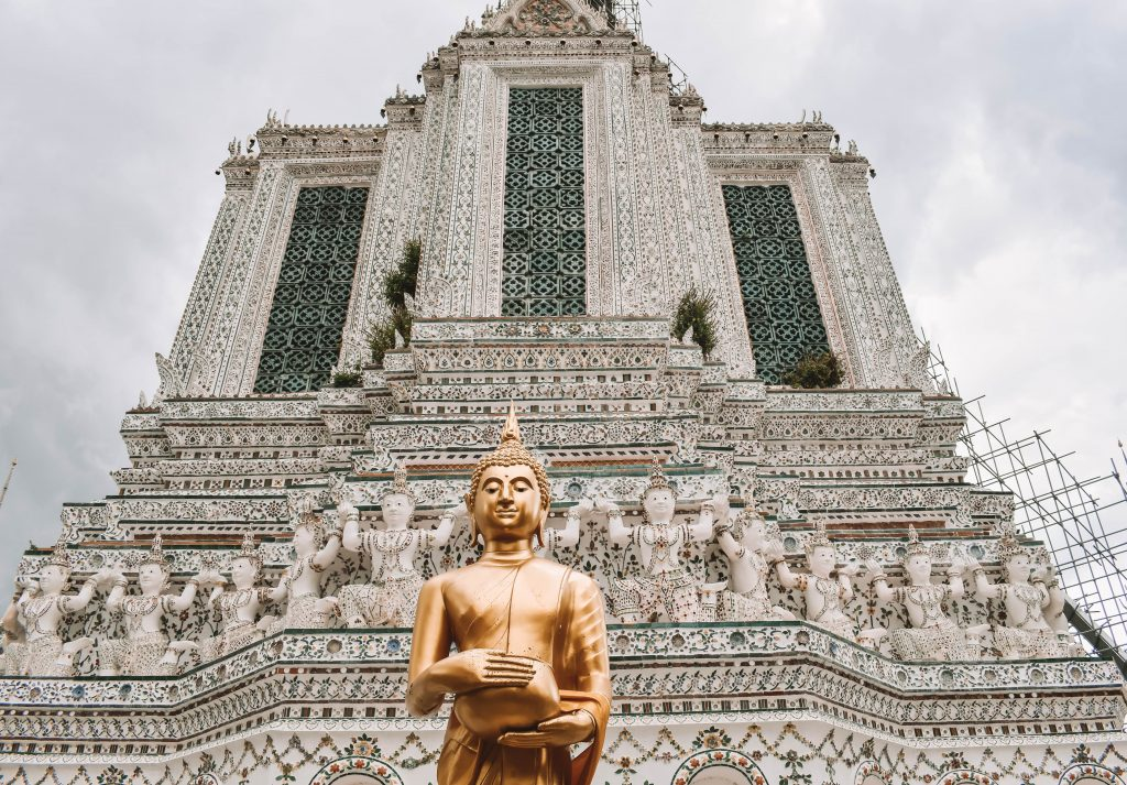 A Buddha in front of Wat Arun temple