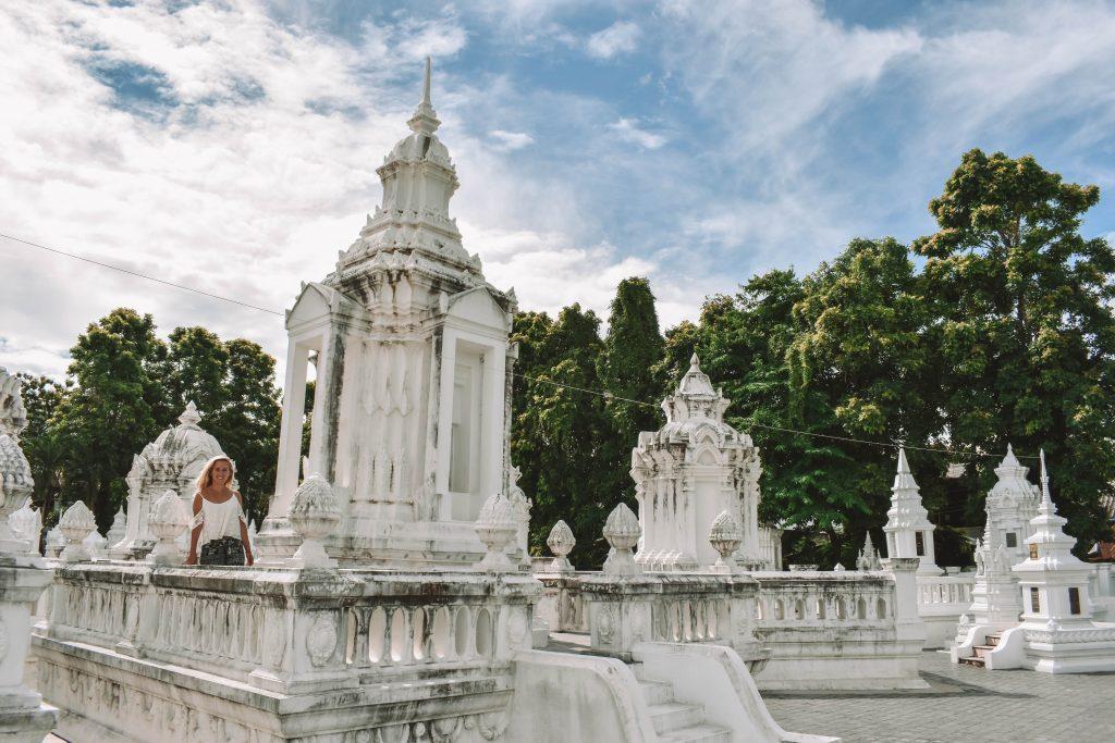 A woman enjoying the Wan Suan Dok temple in Chiang Mai