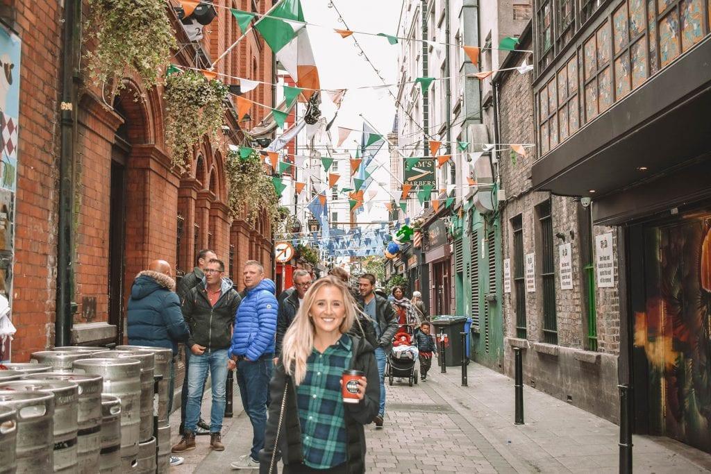 A happy woman enjoying the streets of Dublin