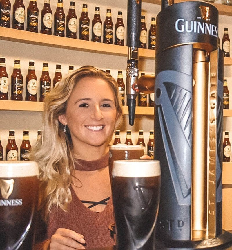 A woman enjoying a Guinness beer at the Guinness Academy
