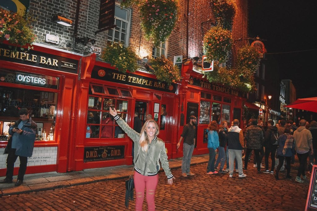 A woman outside of The Temple Bar in Dublin