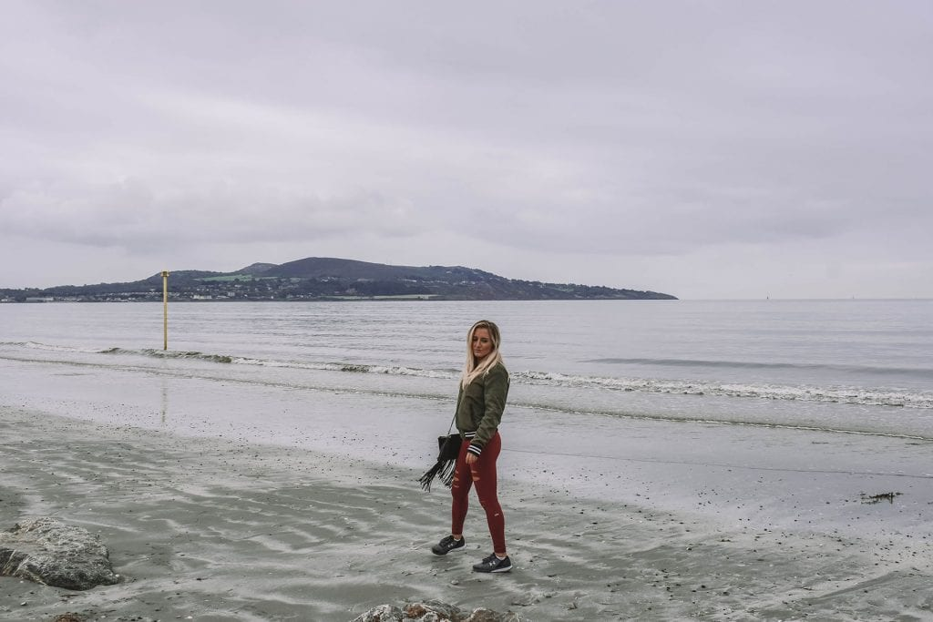 A woman enjoying the beach at Bull Island in Ireland