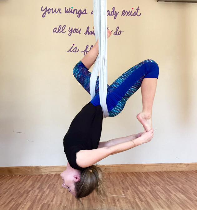 A woman doing aerial yoga at Soul Flyte