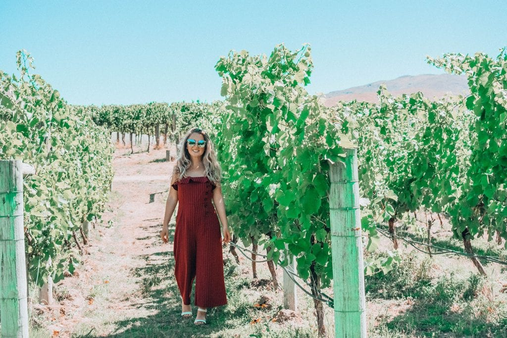 A woman enjoying a beautiful day at a winery