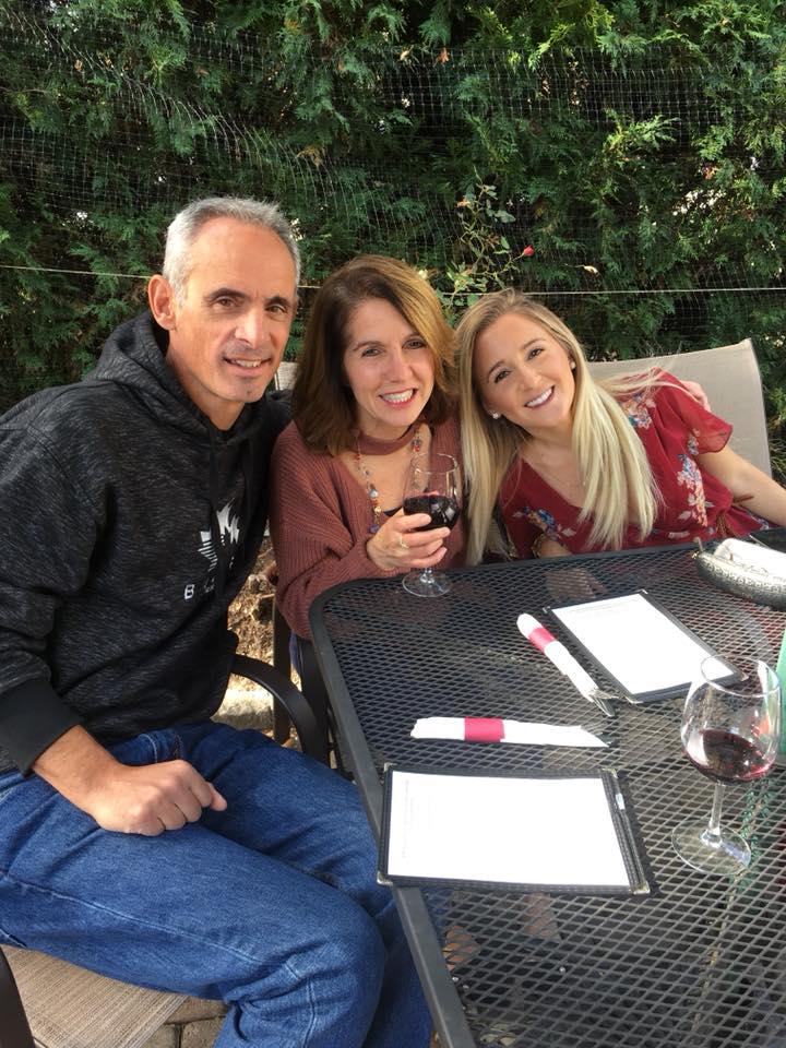 A group of people enjoying wine tasting at Torne Valley Vineyards