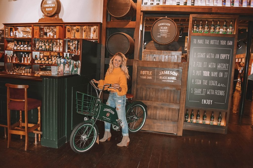 A woman enjoying her time at the Jameson Distillery