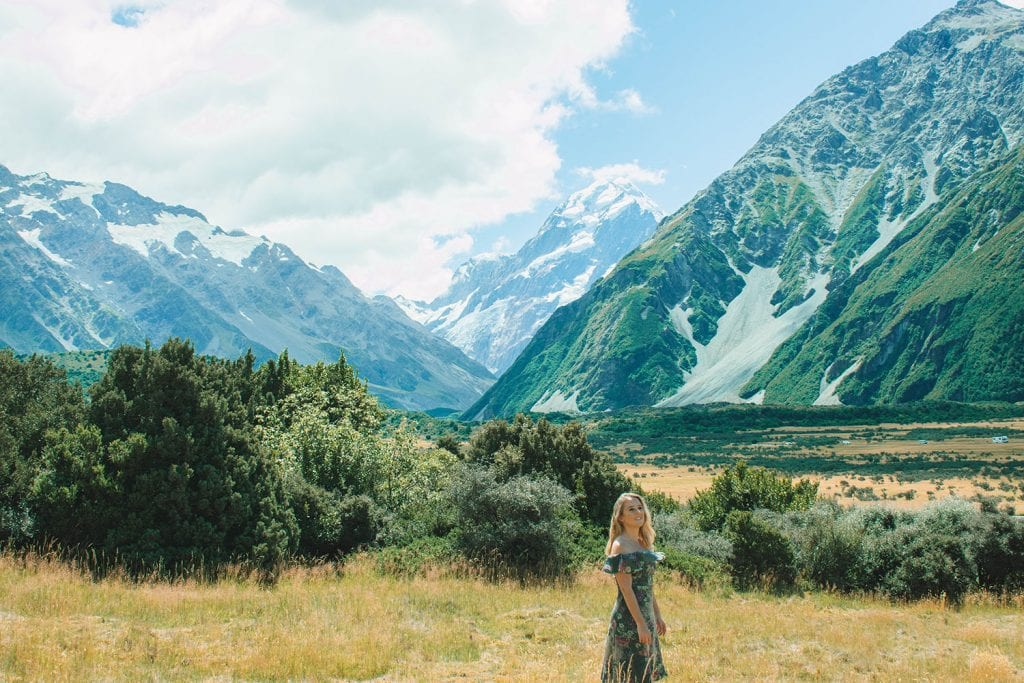A woman exploring Mount Cook National Park in New Zealand