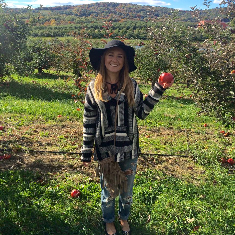 A woman apple picking in the Hudson Valley, New York