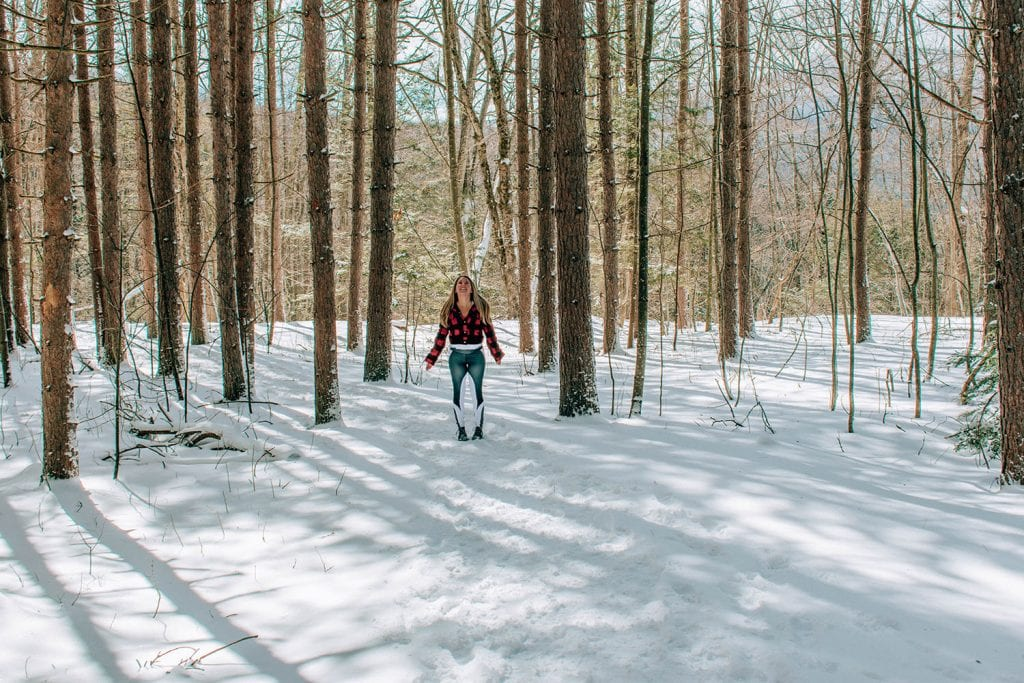 A woman enjoying winter nature in the Catskills
