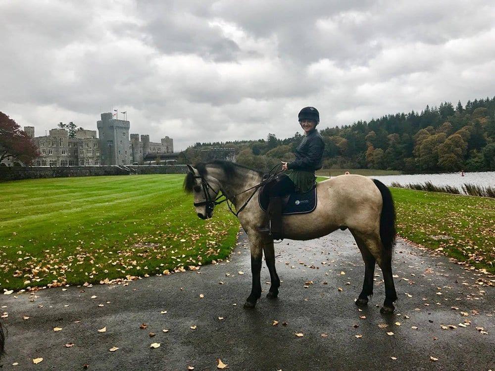 A woman going horseback riding at Ashford Castle