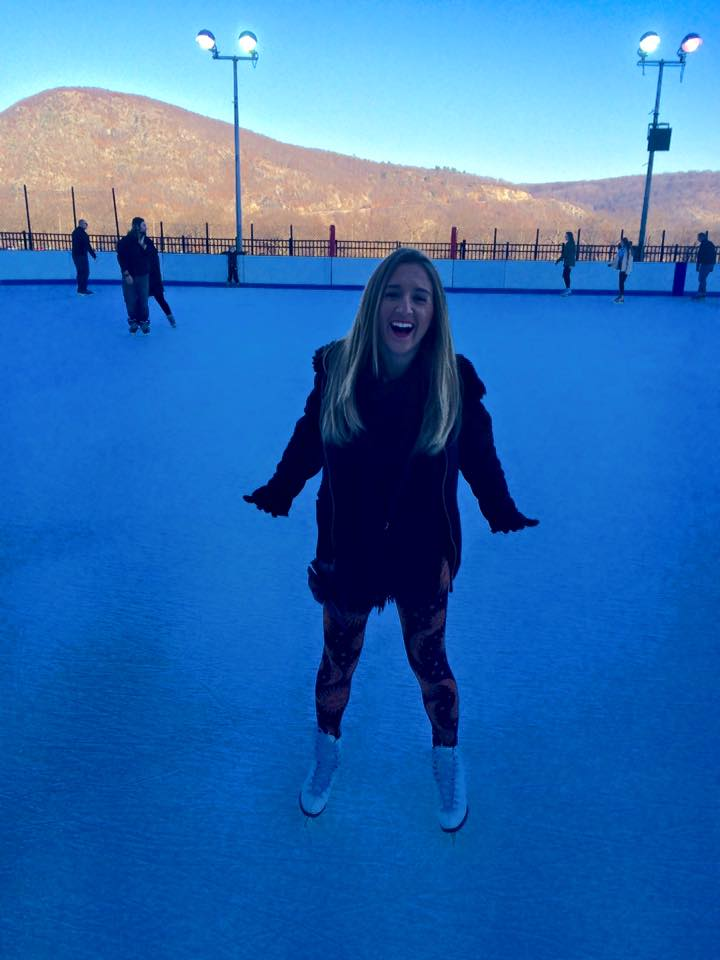 A woman enjoying an ice skating experience at Bear Mountain in New York
