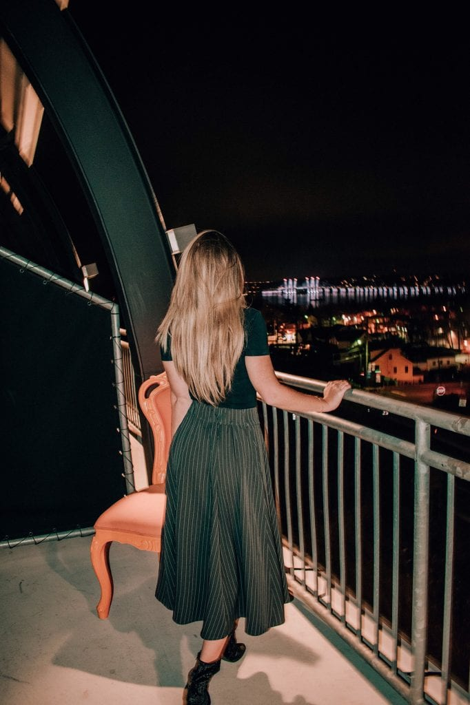 A woman enjoying the night views at The Time Hotel in Nyack