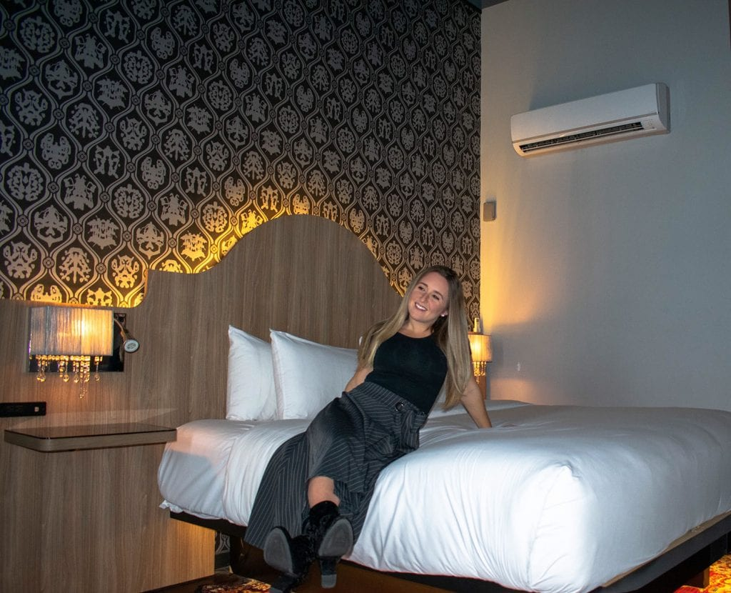 A woman enjoying her hotel room at The Time Hotel in Nyack, New York