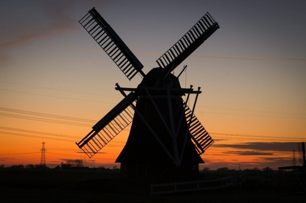 A sunset in Holland with views of a windmill during a day trip