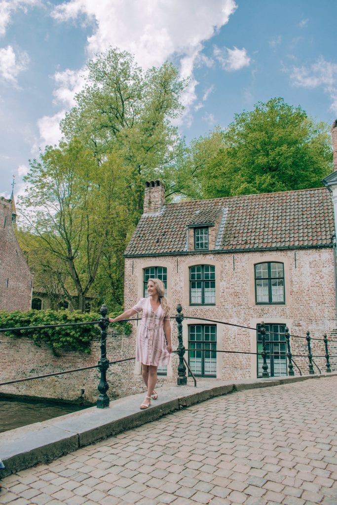 A woman enjoying a lovely day in Brugge, Belgium