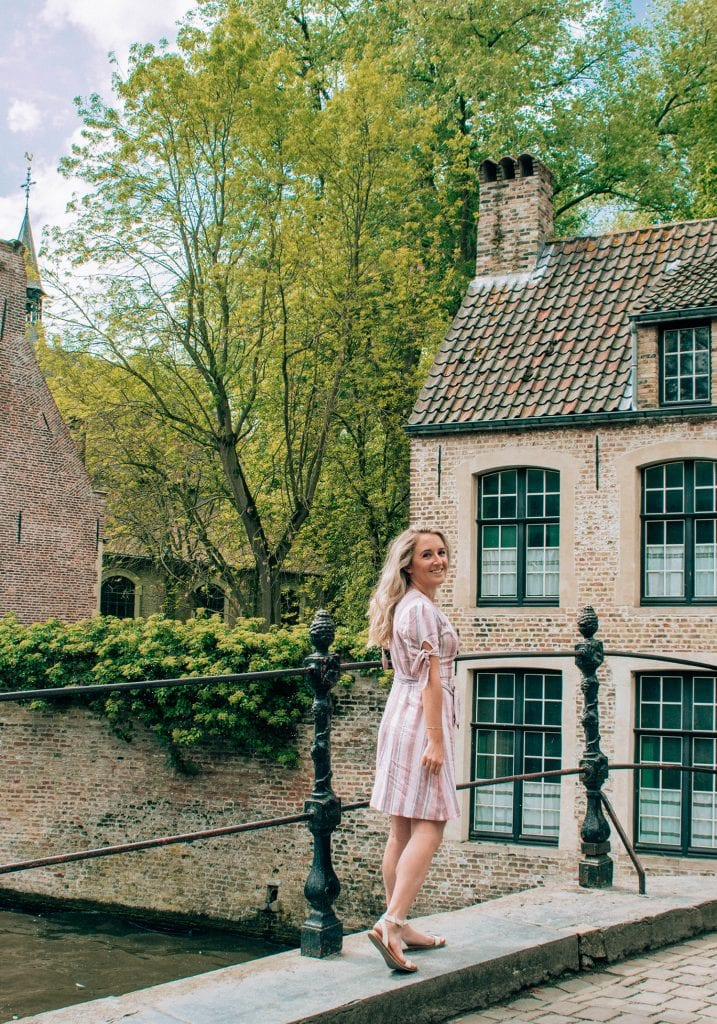 A woman enjoying a beautiful day trip to Bruges from Amsterdam