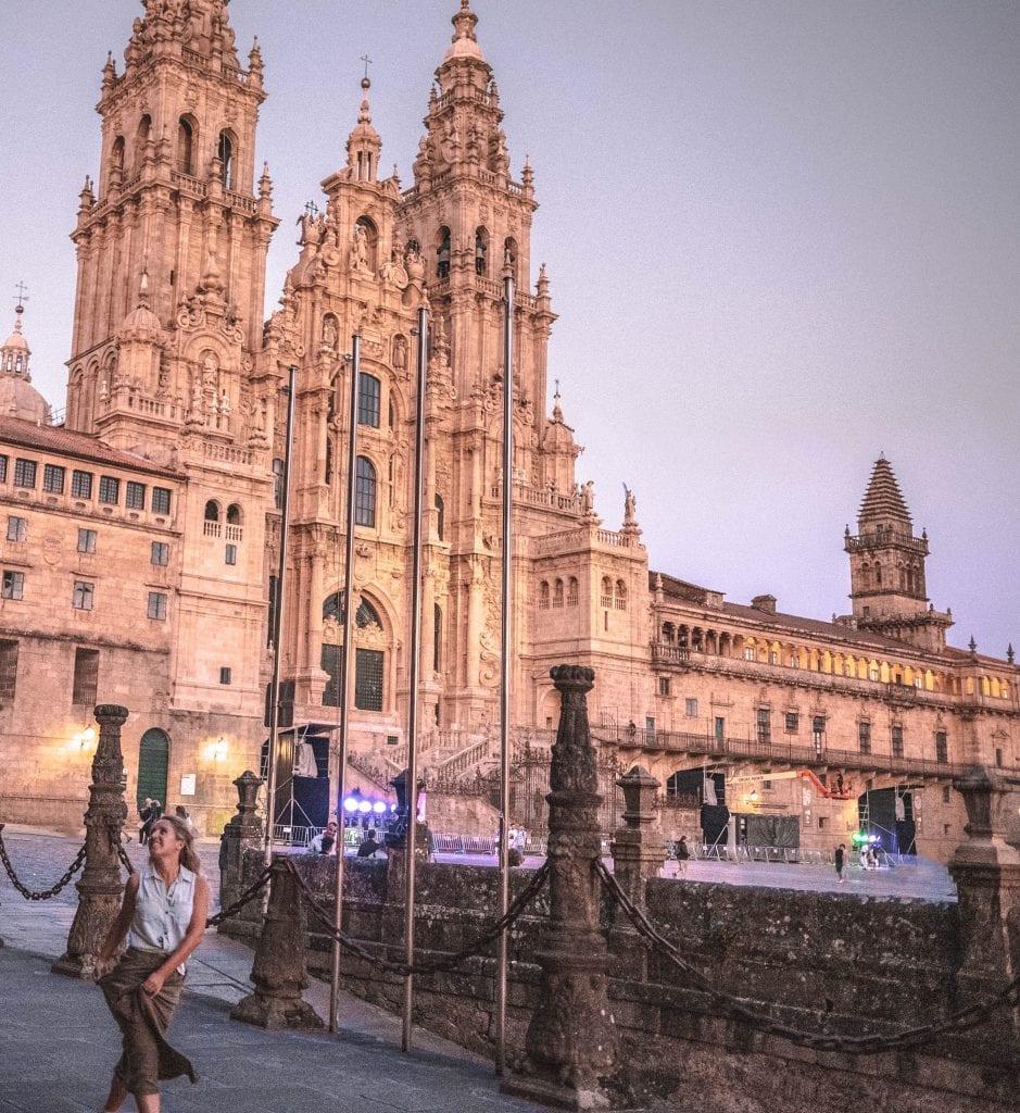 A woman celebrating her Camino de Santiago pilgrimage