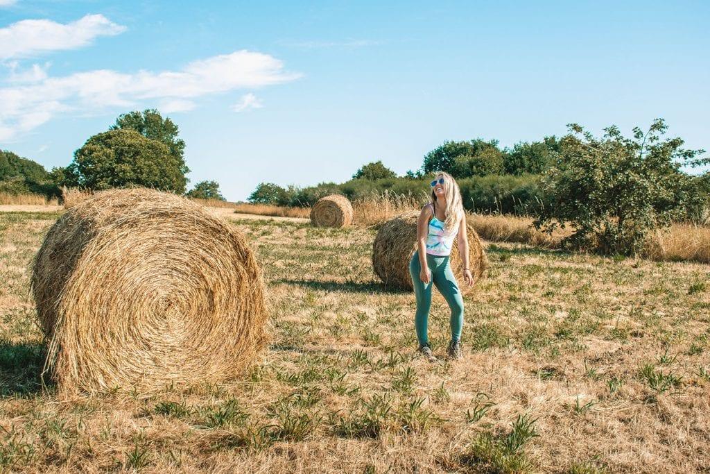 A woman enjoying the rural views along the El Camino de Santiago