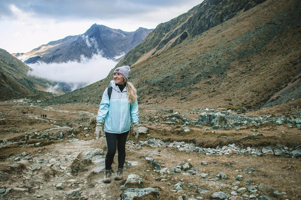 A woman hiking the Andes Mountains in Peru