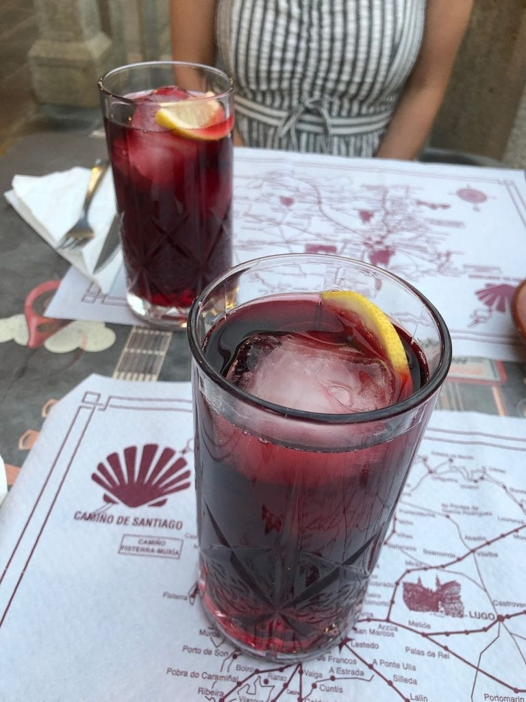 Friends enjoying sangria after a day on the Camino de Santiago