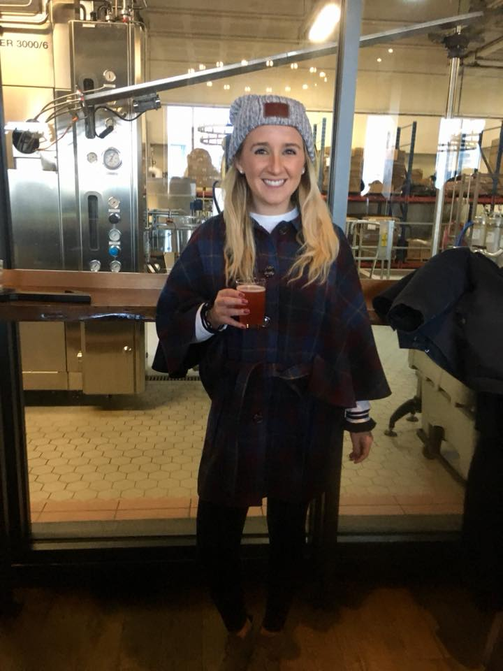 A woman enjoying a beer at Harpoon Brewery in Boston