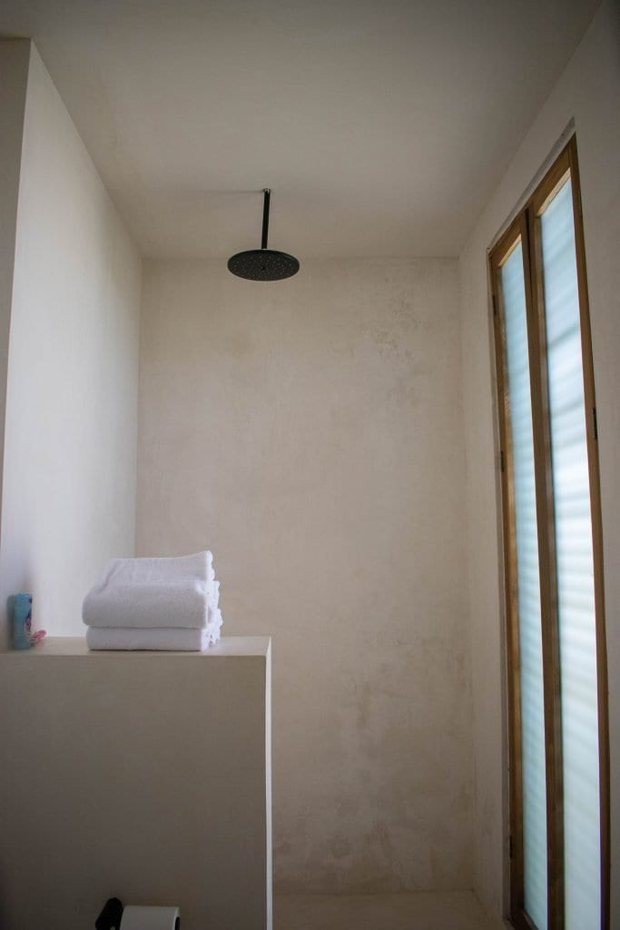 The bathroom in a hotel room at Casa Pueblo boutique hotel in Tulum